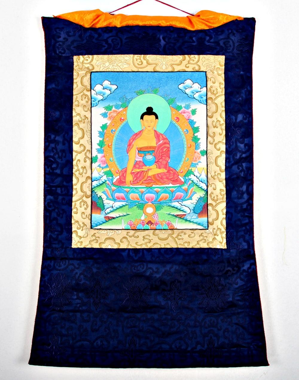 Buddha arts&more - THANGKA DES BUDDHA SHAKYAMUNI IM BLAUEN BROKATRAHMEN